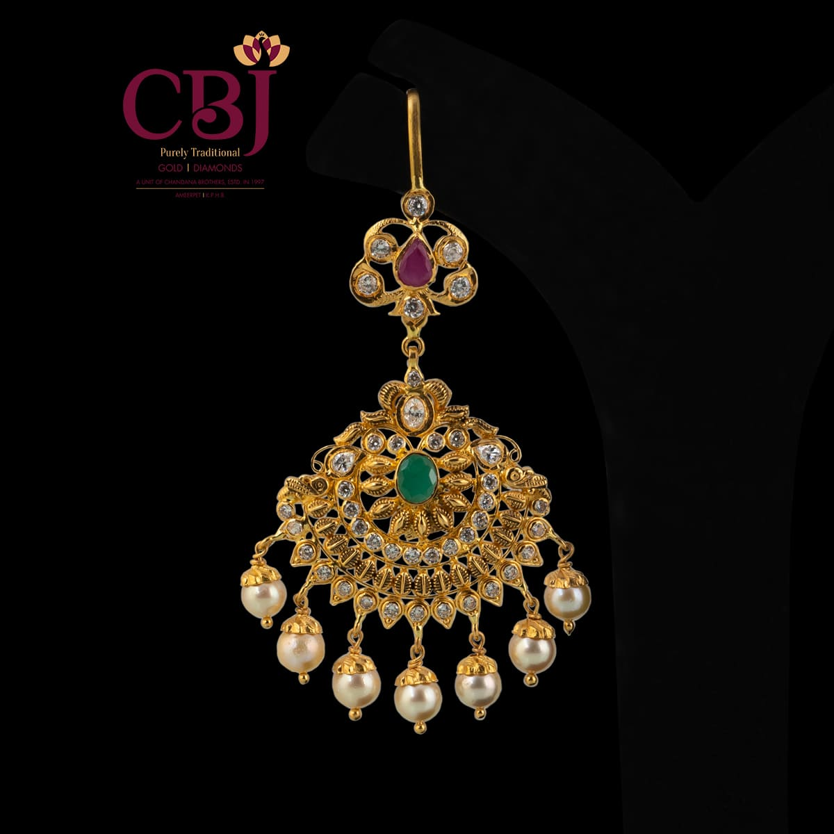 Antique cz tikka featuring rubies, emeralds and pearls.