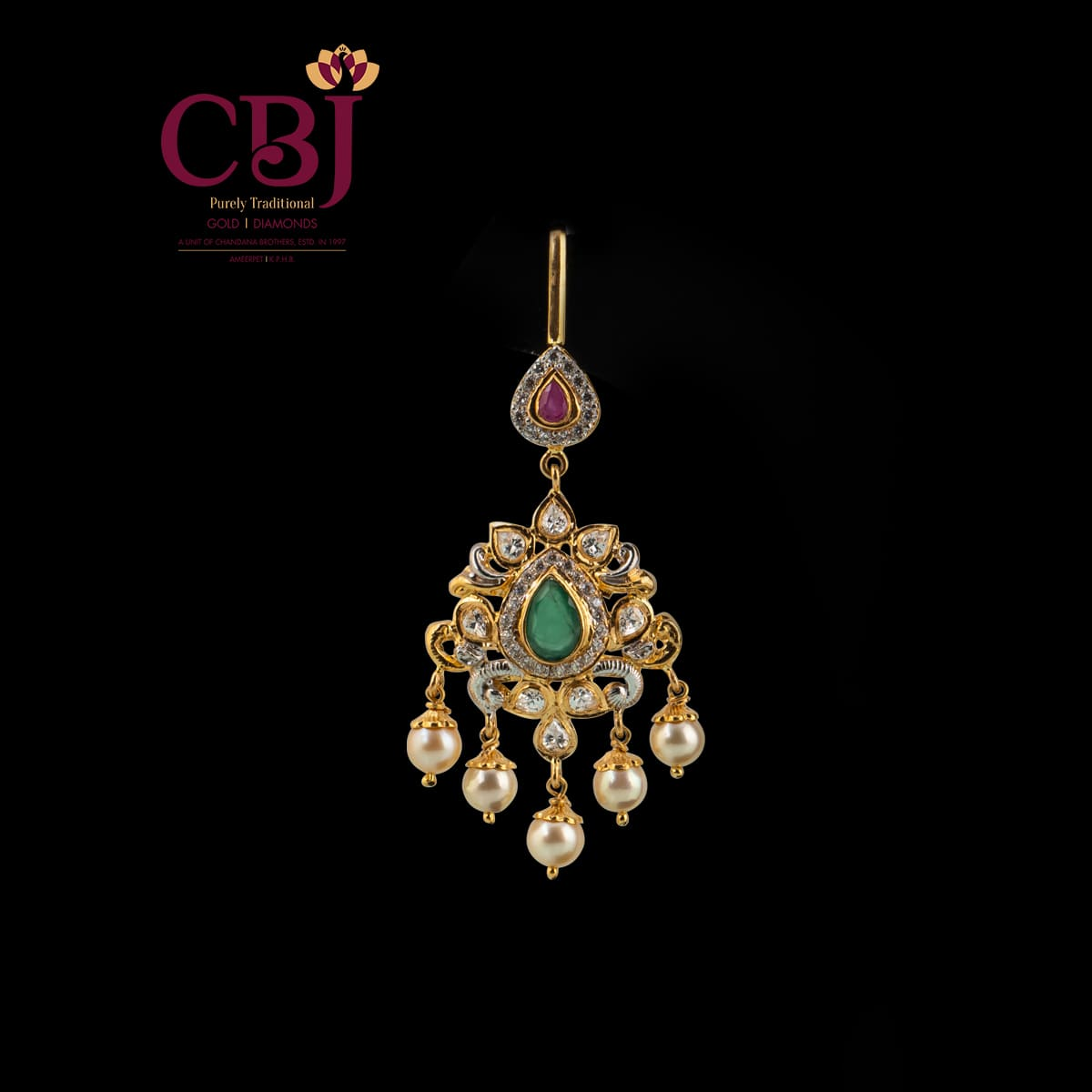 Simple traditional Maang tikka with CZ stones as the highlight.