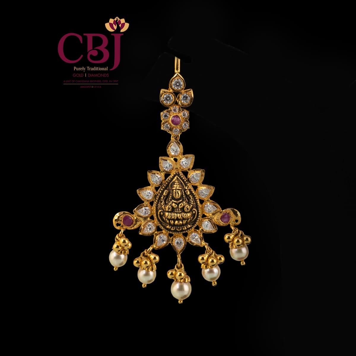 A unique maang tikka with an understated antique design featuring traditional elements.