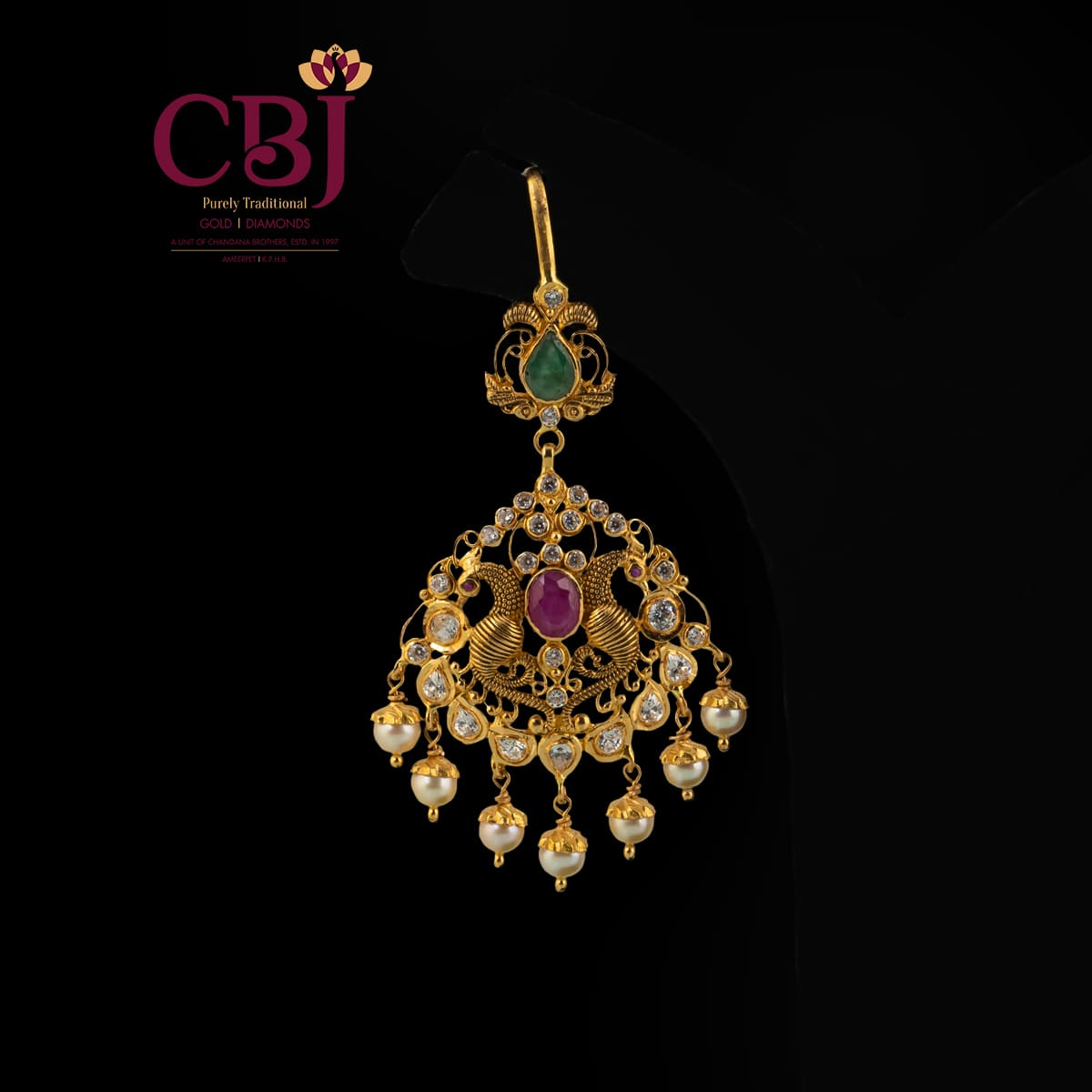 Antique Tikka featuring a peacock design, bejewelled with cz stones.