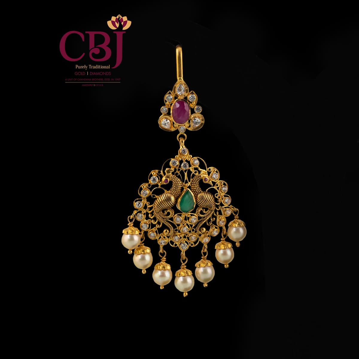Antique maang tikka featuring CZ stones and a peacock design, put together colourfully.