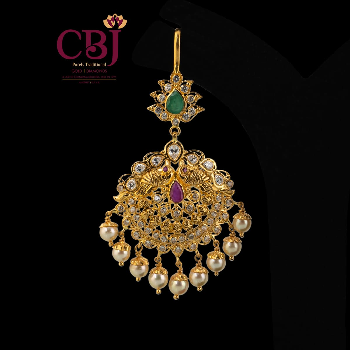 Antique maang tikka featuring CZ stones, put together colourfully.