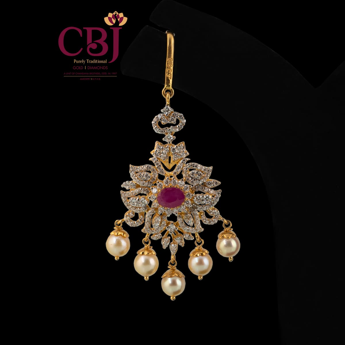 CZ Maang tikka featuring pearls and CZ stones.